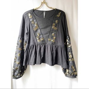 Sequinned black and gold peplum top